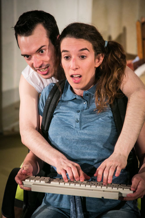 Billy (Ben Calabrese) horns in on Jane's (Maria Giere Marquis) game in The Oregon Trail at Impact Theatre. Photo by Cheshire Isaacs.
