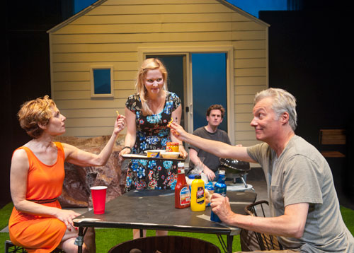 Sharon (Luisa Frasconi) serves appetizers to neighbors Mary (Amy Resnick) and Ben (Jeff Garrett) as Kenny (back, Patrick Kelly Jones) mans the hibachi in Aurora's Bay Area premiere of Detroit. Photo by David Allen.