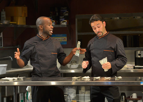 Peter (Shaun Patrick Tubbs) and Jorge (Eric Avilés) count their tips in My Mañana Comes. Photo by Kevin Berne.