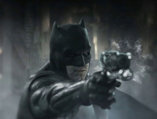 Batman's got a gun.