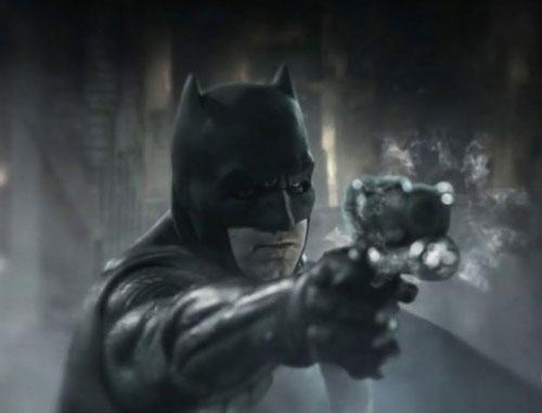 Batman's got a gun.